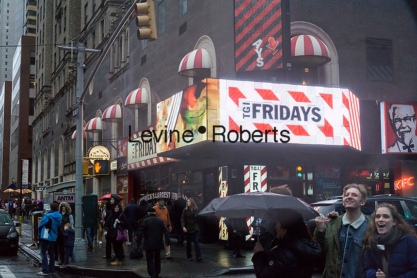 Advertising for TGI Friday's in a storefront in New York containing an assortment of fast food and fast casual restaurants franchised by Reise Restaurants on Sunday, December 18, 2016. (© Richard B. Levine)