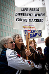 Shelly Bailes, left, and her wife, Ellen Pontac, center, wait for a federal court ruling on California's Proposition 8 at the federal building in San Francisco, California,  August 4, 2010..CREDIT: Max Whittaker for The Wall Street Journal.PROP8