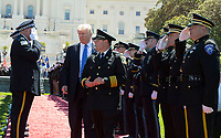 United States President Donald J. Trump arrives to make remarks as Vice President Mike Pence applauds at the 36th Annual National Peace Officers Memorial Service at the US Capitol in Washington, DC, May 15, 2017.<br /> Credit: Chris Kleponis / Pool via CNP /MediaPunch