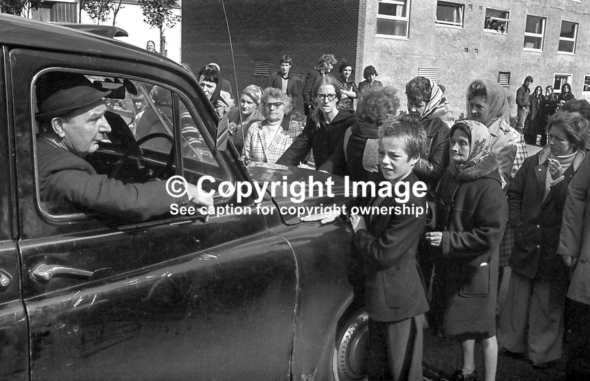 A taxi is held up by women & children blocking the Shankill Road, Belfast, N Ireland. The protest was against lawless elements burning the buses that served the area. September 1976. 197609000485b..Copyright Image from Victor Patterson, 54 Dorchester Park, Belfast, UK, BT9 6RJ..Tel: +44 28 9066 1296.Mob: +44 7802 353836.Voicemail +44 20 8816 7153.Skype: victorpattersonbelfast.Email: victorpatterson@me.com.Email: victorpatterson@ireland.com (back-up)..IMPORTANT: If you wish to use this image or any other of my images please go to www.victorpatterson.com and click on the Terms & Conditions. Then contact me by email or phone with the reference number(s) of the image(s) concerned.