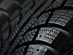 tire; tread; tires; wheels; wheel; winter; winter tire; rubber; car; auto; automobile; automotive; detail; details; pattern; grooves; groove; texture; surface; tread pattern; tire; tyres; tyre; car tires; car tire; winter tires; nobody; background; backgrounds; closeup; close up; close-up; dark; black; macro; shallow focus; copyspace; copy space