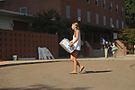 A woman carries a box into Stockard-Martin Dorm at the University of Mississippi in Oxford, Miss. on Friday, August 19, 2011. Classes begin on Monday, August 22, 2011.
