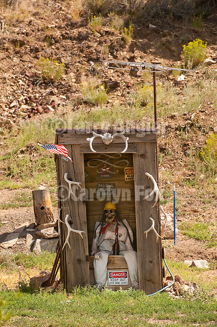 Wooden outhouse with mannequin, antlers, kitsch