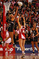 Casey Williams leaps to try to block Rachel Dunn's shot during the New World International Netball Series between the NZ Silver Ferns and England at Arena Manawatu, Palmerston North, New Zealand on Wednesday, 18 October 2008. Photo: Dave Lintott / lintottphoto.co.nz