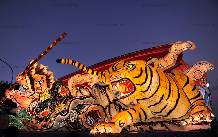 Nebuta festival is celebrated in Amori at the begining of the month of August and it is one of the main summer festivals in Japan. Big structures of metal and painted japanese paper are created to represent scenes of devils and warriors. In the evening, during the parade, hundreds of bulbs are lighted up inside each figure to make them come alive. Aomori. Japan.