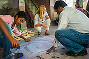 Italian Designer, Gabriella Cortese of Antik Batik interacts with workers while they imprint the design on to fabric at a batik workshop in Jaipur, Rajasthan, India.