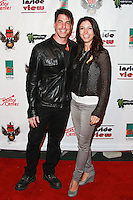 LOS ANGELES, CA, USA - OCTOBER 26: Phil Buckman, Lauren Tarantino arrive at An Evening Of Art With Billy Morrison And Joey Feldman Benefiting The Rock Against MS Foundation held at Village Studios on October 26, 2014 in Los Angeles, California. (Photo by David Acosta/Celebrity Monitor)