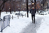 People walk through the snow on February 13, 2014 in New York City. The latest storm was expected to dump up to 14 inches on some parts of the city.e. Photo by Kena Betancur / VIEWpress.