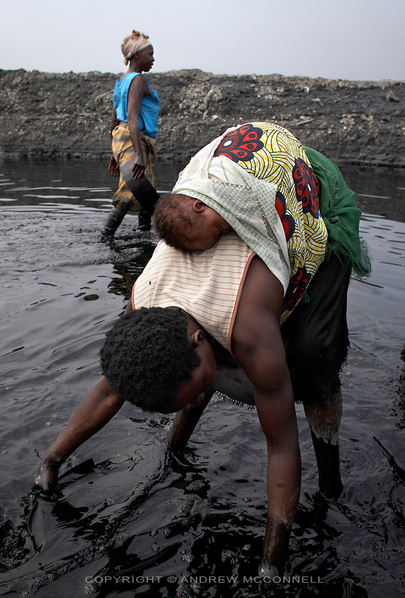 A mother works with her baby on her back at Lake Katwe.