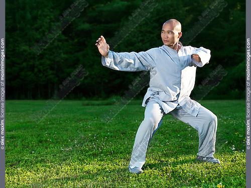 Shaolin monk practicing Baduanjin Qi Gong outdoors