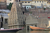 Sinking temple on the Ganges River near Scindia Ghat, Varanasi, India