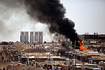 DOMIZ, IRAQ:  Two tents are set ablaze by stoves left by refugees who went to greet Angelina Jolie as she visits Syrian refugees in the Domiz refugee camp in Iraq...US actress and UNHCR special envoy Angelina Jolie is on a visit to refugees of the Syrian conflict...Photo by Ali Arkady/Metrography