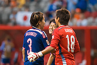 June 23, 2015: Saori ARIYOSHI of Japan looks at Ayumi KAIHORI after the final whistle at a round of 16 match between Japan and Netherlands at the FIFA Women's World Cup Canada 2015 at BC Place Stadium on 23 June 2015 in Vancouver, Canada. Japan won 2-1. Sydney Low/AsteriskImages.com
