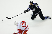 Trevor Lewis (Los Angeles Kings, #22) passes while being on knees during ice-hockey match between Los Angeles Kings and Detroit Red Wings in NHL league, February 28, 2011 at Staples Center, Los Angeles, USA. (Photo By Matic Klansek Velej / Sportida.com)