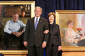 Washington, DC - December 19, 2008 -- United States President George W. Bush and Laura Bush stand next to their portraits at the unveiling of the National Portrait Gallery's Portraits of The President and Mrs. Bush at the National Portrait Gallery in Washington DC, Friday,  December 19, 2008. .Credit: Ken Cedeno / Pool via CNP