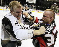 Binghamton Senators right wing Jeremy Yablonski, right, throws a punch at San Antonio Rampage right wing Francis Lessard during a fight in the second period of an AHL hockey game, Jan. 29, 2009, in San Antonio, Texas. (Darren Abate/pressphotointl.com)