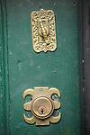 Detail of gold locks on a green door in Beacon Hill in Boston, MA.