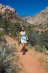 Woman hiking at Willow Springs Trail in Red Rock State Park near Las Vegas, Nevada, NV, woman hiker, model released, hiking, hiking path, image nv401-18078  .Photo copyright: Lee Foster, www.fostertravel.com, lee@fostertravel.com, 510-549-2202