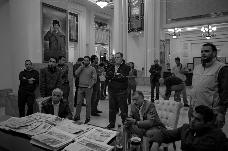 Tripoli, Libya, March 17, 2011.Libyan security personel and members of the Foreign Media Department watch in stunned silence as the UN Security Concil votes a strong resolution against Libya.