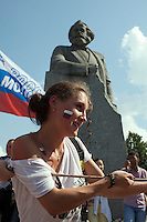 Moscow, Russia, 12/06/2010..Members of the pro-Kremlin youth group Young Russia in a tug-of-war under a statue of Karl Marx during a Young Russia event and concert to mark the Russia Day national holiday.