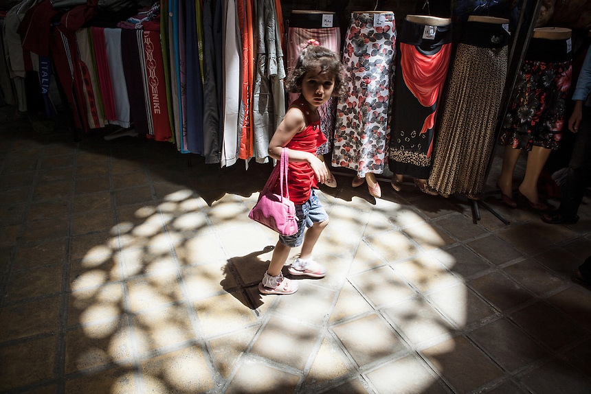 A little girl at Yazd Bazaar. Yazd is one of the oldest living city in the world. Yazd was visited by Marco Polo in 1272, who described it as a good and noble city and remarked its silk production. The name Yazd means worship. And badgir is one of distinctive feature of this city.