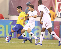 Alejandro Bedoya #11 of the USA loses the ball to Andre Santos #6 of Brazil during an international friendly matchl in Giants Stadium, on August 10 2010, in East Rutherford, New Jersey.Brazil won 2-0.