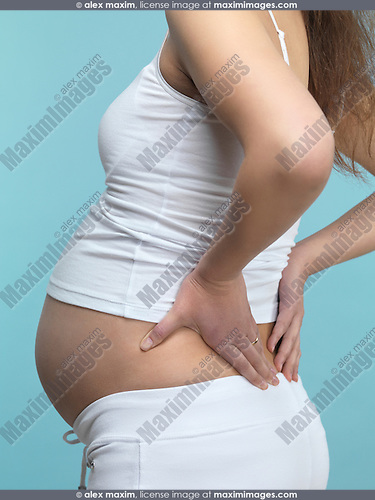 Pregnant woman rubbing her back