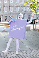 NO REPRO FEE. 18/10/2011. Cross partyTDs  to put aside party differences for Alzheimers. Cross party elected officials will join forces with a giant purple post it character outside the gates of Dail Eireann to remind elected officials to sign up to the Alzheimer Pledge to bring in a National Dementia Strategy for Ireland.  Picture James Horan/Collins Photos