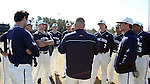 CARY, NC - MARCH 05: Notre Dame assistant coach Jesse Woods (center) talks to his players before the game. The Monmouth University Hawks played the University of Notre Dame Fighting Irish on March 5, 2017, at USA Baseball NTC Field 2 in Cary, NC in a Division I College Baseball game, and part of the Irish Classic tournament. Notre Dame won the game 4-0.