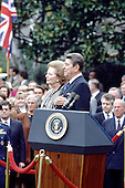 Washington, DC - (FILE) -- United States President Ronald Reagan, right, hosts a welcoming ceremony for Prime Minister Margaret Thatcher of Great Britain on the South Lawn of the White House in Washington, D.C. on Wednesday, November 16, 1988..Credit: Ron Sachs / CNP