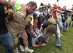 BOSTON, MA - July 25, 2004: An antiabortion protester is roughed up by peace activists as the media looks on in the Boston Common the day before the start of the 2004 Democratic National Convention.