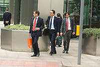 American investment bank Lehman Brothers goes into administration. Staff at the Canary Wharf branch of the bank in London are seen leaving work early with their possessions.