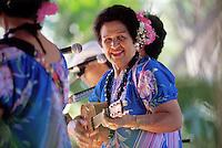 EDITORIAL ONLY. Auntie Genoa Keawe playing ukulele and singing at the Ka Hula Piko Festival on Molokai