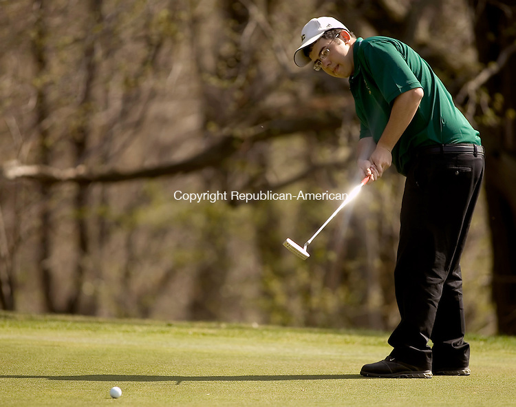 WATERBURY, CT- 24 APRIL 2008 --042408JS11--Holy Cross' Frank Lerz putts during their meet against Wolcott Thursday at Western Hills Golf Course in Waterbury. <br /> Jim Shannon / Republican-American