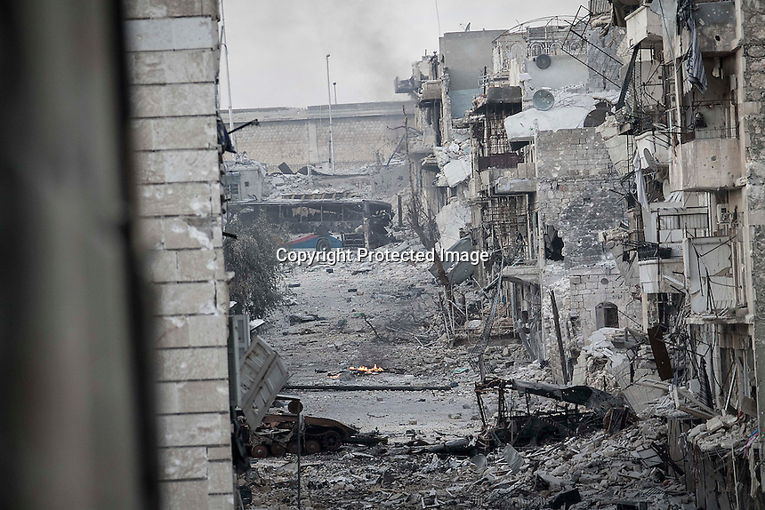 In this Wednesday, Oct. 31, 2012 photo, a view of one of the streets at the battlefield in the nearby Karmal Jabl battlefield in Aleppo, the Syrian's largest city. Violent clashes reignited along the city's front line while warplanes attacked the rebel controlled areas throughout the financial capital of the Muslim country. (AP Photo/Narciso Contreras).