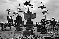 """Baghdad, Iraq, June 13, 2003.Roadside """"advertisement"""" for tyres repairers in Saddam City."""