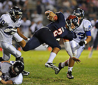 Cypress Nick Buras gets airborne as he picks up yardage against Pacifica in an Empire League game at Western<br /> High.