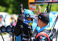 May 14, 2016; Commerce, GA, USA; NHRA top fuel driver Clay Millican (left) high fives a crew member during qualifying for the Southern Nationals at Atlanta Dragway. Mandatory Credit: Mark J. Rebilas-USA TODAY Sports