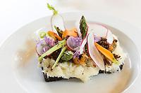 Lunch snacks cod fish Smorrebrod - smorgasbord Nordic open sandwich on minimalist white china plate - in Denmark
