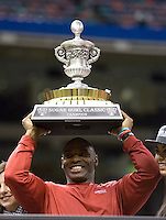Louisville head coach Charlie Strong holds up Sugar Bowl champion trophy after winning 79th Sugar Bowl game against Florida at Mercedes-Benz Superdome in New Orleans, Louisiana on January 2nd, 2013.   Louisville Cardinals defeated Florida Gators, 33-23.
