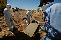 A total of 29 bodies were unloaded from an unmarked truck as they waited to be buried in a mass grave at the San Rafael Cemetery in the outskirts of Ciudad Juarez, Mexico on the afternoon of April 20, 2010. Twenty five men and four women of various ages rested under the afternoon sun before being unloaded into their respective final burial grounds. These are part of the many unclaimed bodies that pile up on the city morgue each month. Every three to four months, the city moves these bodies to one of a handful of cemeteries that serve as the final resting site for those who's family members have not stepped forward to lay claim to them. ..A genetic map is performed to each body, in the eventuality that relatives might come forward in the future to lay claim to their loved ones. Each coffin, made out of compressed and recycled wood, is assigned a serial number to help officials determine the identity of the remains as they compare this to their assigned DNA map. ..Some of the bodies buried on this day, were from people who were originally from other parts of the country. ..©Javier Manzano