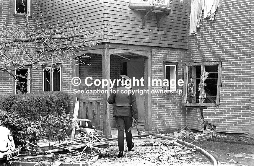 Policeman at the scene of the explosion in which Larry McMahon, Newtownabbey, Co Antrim, married, 4 children, Roman Catholic, died.  Mr McMahon was murdered by the UVF, Ulster Volunteer Force, a loyalist paramilitary organization, on 15th March 1973. An explosive device detonated killing him instantly when he went to investigate a noise at his front door at 21.45. His wife and some of his children were also injured. Mr McMahon's success was a rags to riches story. He started off as a barman and endied up owning the Royal Hotel in Whitehead and a chain of betting shops and three pubs. 197303150134c<br /> <br /> Copyright Image from Victor Patterson, 54 Dorchester Park, Belfast, United Kingdom, UK.  Tel: +44 28 90661296; Mobile: +44 7802 353836; Voicemail: +44 20 88167153;  Email1: victorpatterson@me.com; Email2: victor@victorpatterson.com<br /> <br /> For my Terms and Conditions of Use go to http://www.victorpatterson.com/Terms_%26_Conditions.html