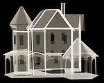 X-ray image of a paper house (brown on black) by Jim Wehtje, specialist in x-ray art and design images.