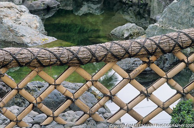 A simple fence constructed of bamboo and rope sums up the  Japanese sense of style and simplicity.