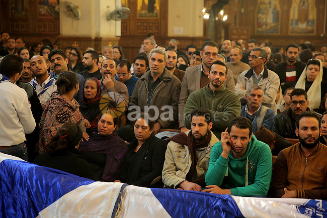 Egyptian Christians  attend the funeral of the victims of a bomb explosion that targeted a Coptic Orthodox Church the previous day in Cairo, in the Egyptian capital's Nassr City neighbourhood on December 12, 2016. Photo by Church Media Office