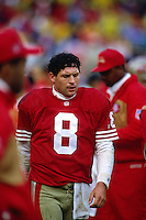 SAN FRANCISCO, CA - Quarterback Steve Young of the San Francisco 49ers walks on the sidelines during a game at Candlestick Park in San Francisco, California in 1993. Photo by Brad Mangin