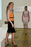 85 Broads member walks runway in a SS10 two toned bustier dress by Yuna Yang, during the 85 Broads Presents Yuna Yang trunk show at Art Gate Gallery on October 24th 2011.