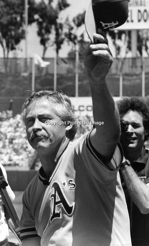 """Oakland Athletics pitcher Jim """"Catfish"""" Hunter is honored by the A's at ceremony at the Oakland Alameda County Coliseum in 1991. (photo by Ron Riesterer)"""