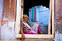 India, Jodhpur, Blue City, Historical City, Rajasthani woman sitting in entrance