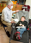 PLYMOUTH, CT 06 December 2008-010609SV04--Dentist Hugh Hunsingerworks with Michael Zalewski, 6, at Plymouth Center School in Plymouth Tuesday. The dentist and two hygienists were visiting Plymouth Center School to clean and examine the teeth of students.  Steven Valenti Republican-American
